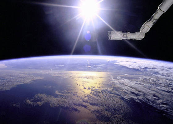 robot_arm_over_earth_with_sunburst_-_gpn-2000-001097.jpg